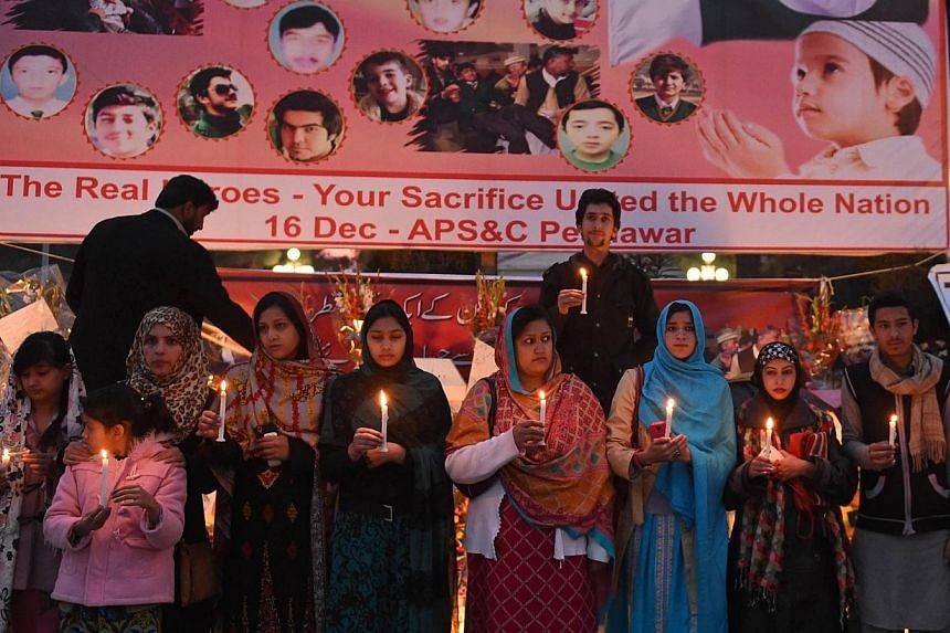 Pakistani demonstrators light candles during a vigil for victims of the Peshawar school massacre in Quetta on Dec 21, 2014.Pakistan plans to execute around 500 militants in coming weeks, officials said Monday, after the government lifted a mora