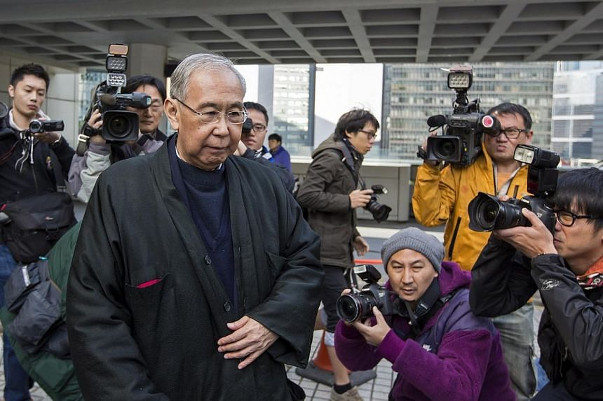Hong Kong's former chief secretary Rafael Hui leaves during a lunch break at the High Court in Hong Kong, in this Dec 16, 2014 file photo. Lawyers for Hong Kong property tycoon Thomas Kwok and the government's former deputy leader Rafael Hui pre