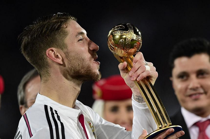 Real Madrid's defender Sergio Ramos poses with the trophy of the best player at the end of the FIFA Club World Cup final football match against San Lorenzo at the Marrakesh stadium in the Moroccan city of Marrakesh on Dec 20, 2014. Decorated Rea