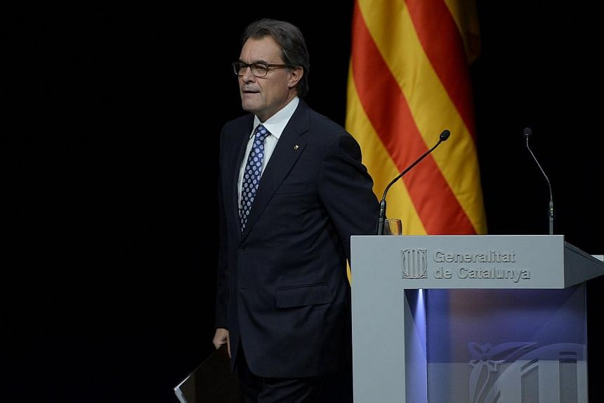Catalonia's High Court said on Monday, Dec 22, 2014, that it would open proceedings over the alleged disobedience of regional President Artur Mas and other local leaders for holding a symbolic vote on independence from Spain in November. -- PHOTO: AF