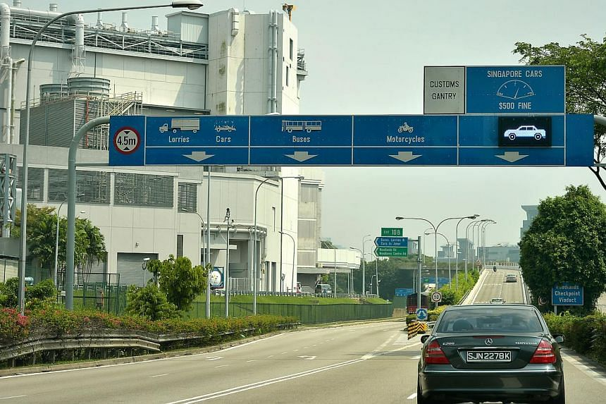 """The Ministry of Transport is studying Malaysia's new levy on foreign-registered vehicles going into the country from Singapore, and will decide on a response """"in due course"""", it said on Monday, Dec 22, 2014. -- ST FILE PHOTO"""