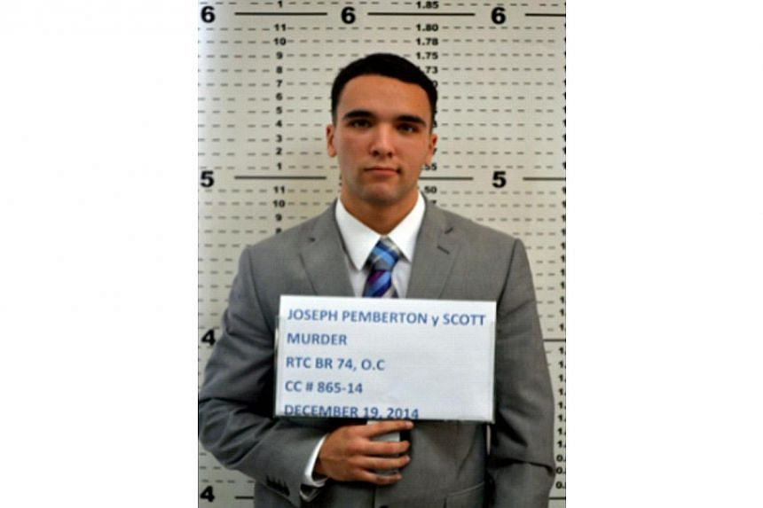 This handout photo released by Olongapo City Police Public Information Office taken on Dec 19, 2014, shows Private First Class Joseph Pemberton at the Olongapo police station in Olongapo, north of Manila. -- PHOTO: AFP