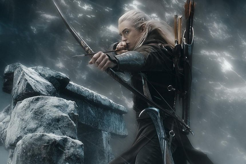 Orlando Bloom as Legolas fires an arrow as The Hobbit: The Battle Of The Five Armies heated up the holiday season box office in the United States and Canada. -- PHOTO: WARNER BROS