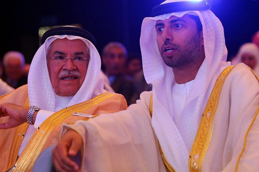 Saudi Oil Minister Ali al-Naimi (left) speaks with United Arab Emirates Energy Minister Suhail bin Mohamed al-Mazroui (right) during the opening session of the 10th Arab Energy Conference in Abu Dhabi, on Sunday. -- PHOTO: AFP