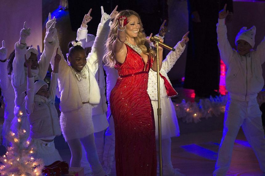 Singer Mariah Carey performs at the lighting ceremony for the 82nd Rockefeller Center Christmas tree, at Rockefeller Center in midtown Manhattan in New York City, on Dec 3, 2014. -- PHOTO: REUTERS