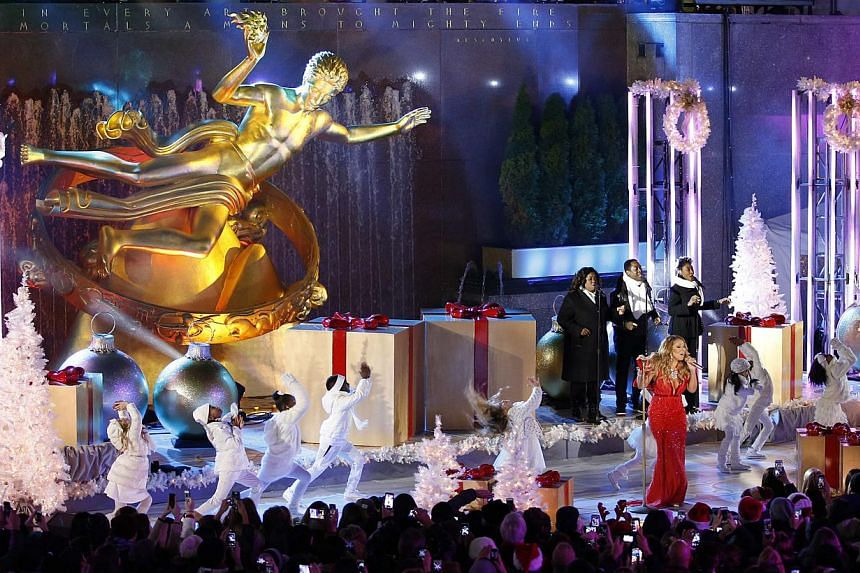 Singer Mariah Carey performs at the lighting ceremony for the 82nd Rockefeller Center Christmas tree at Rockefeller Center in midtown Manhattan in New York City, on Dec 3, 2014. -- PHOTO: REUTERS