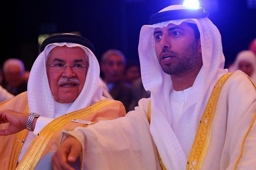 Saudi Oil Minister Ali al-Naimi (centre) with United Arab Emirates Energy Minister Suhail  al-Mazrouei (right) during the opening session of the 10th Arab Energy Conference in Abu Dhabi on Dec 21, 2014. Mr Naimi, the de facto leader of the Organ