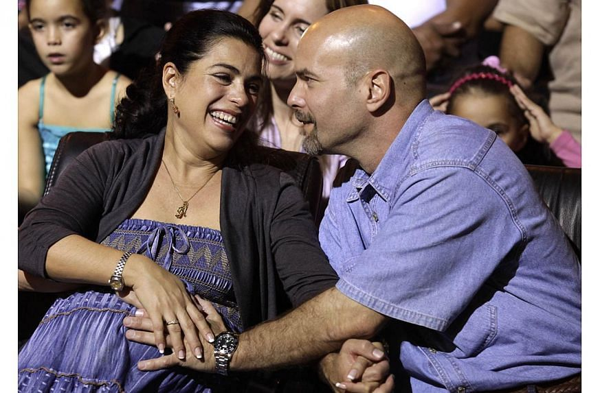 Mr Gerardo Hernandez and his wife, Ms Adriana Perez, are expecting his baby in two weeks, even though he was locked up for 16 years without conjugal visits. It will be a girl called Gema, Cuban official media said. -- PHOTO: REUTERS