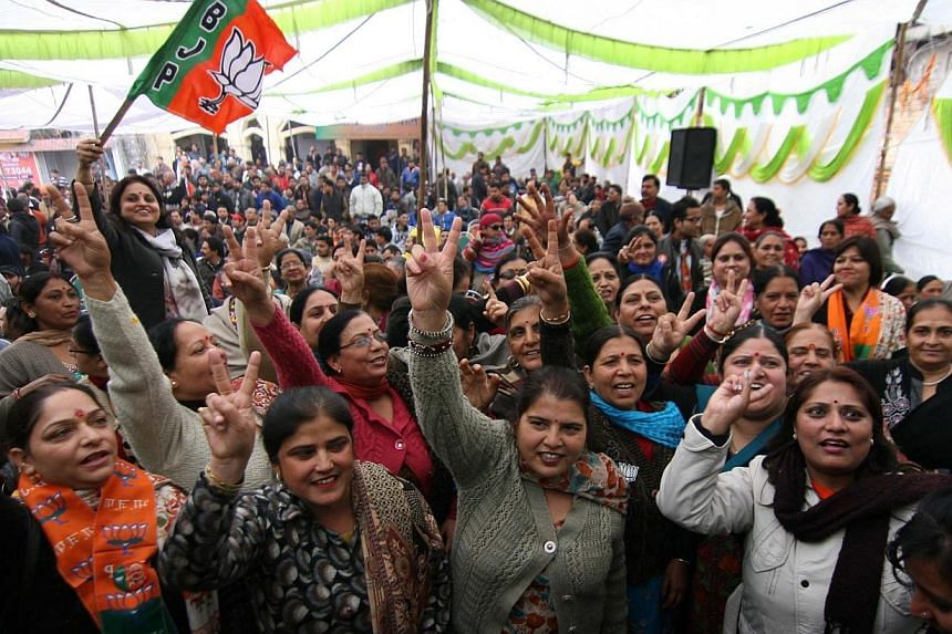 Bharatiya Janata Party (BJP) supporters celebrate after their party's victory in Jammu constituency, in Jammu on Dec 23, 2014.Indian Prime Minister Narendra Modi's Hindu nationalist party made significant election gains in the restive Muslim-ma