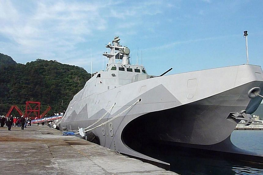 Taiwan's first domestically-produced missile corvette, the 500-ton ship Tuo Chiang (Tuo River), is pictured during the vessel's launch ceremony at the naval port at Suao in northeastern Taiwan's Yilan county on Dec 23, 2014.Taiwan on Tuesday la