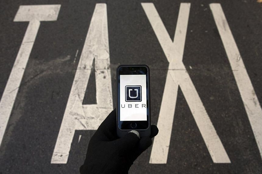 Taiwan has slapped a string of fines on app-based taxi service Uber for operating illegally, the latest blow to the US company which is embroiled in a number of international disputes. -- PHOTO: REUTERS