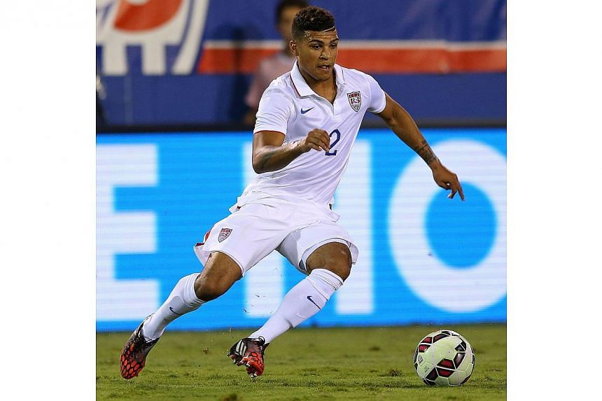 DeAndre Yedlin of the USA brings the ball upfield during a game against Honduras at FAU Stadium on Oct 14, 2014, in Boca Raton, Florida. Yedlin is joining Tottenham in January, the north London football club announced on Tuesday. -- PHOTO: AFP