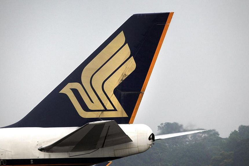 A total of 14 passengers and crew were injured after sudden severe turbulence hit a Singapore Airlines (SIA) flight from Osaka, which landed in Singapore on Tuesday morning. -- PHOTO: ST FILE