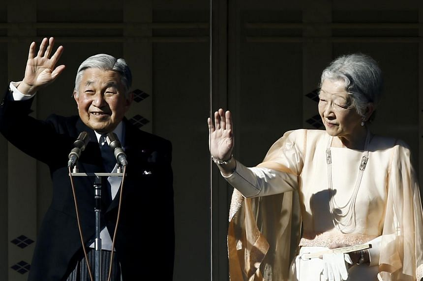 Japan's Emperor Akihito (left) stands next to Empress Michiko (right) as they wave to well-wishers gathered to celebrate his 81st birthday at the Imperial Palace in Tokyo on Dec 23, 2014. -- PHOTO: REUTERS
