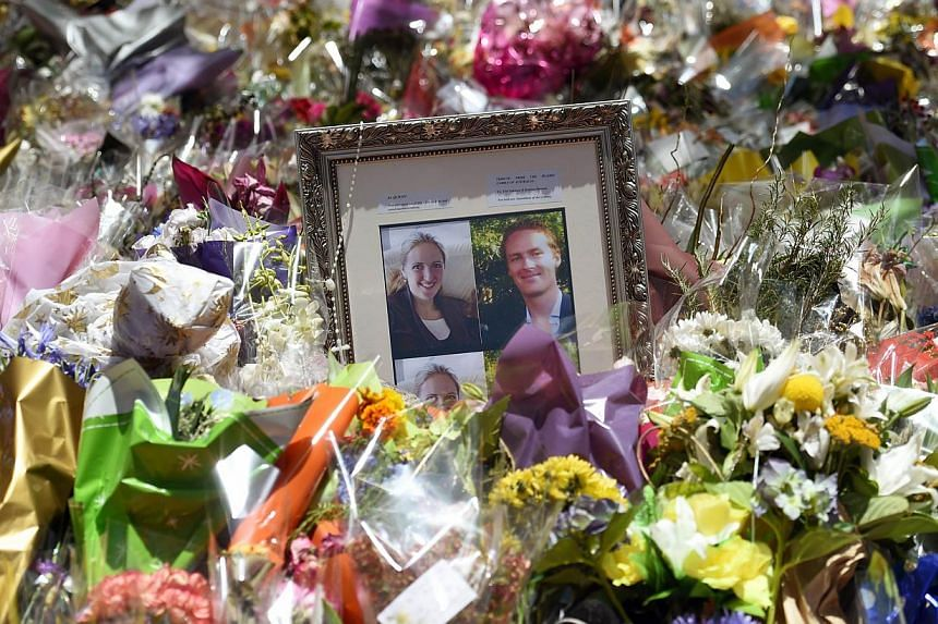 Framed photographs of Katrina Dawson, a 38-year-old barrister, and Tori Johnson, the 34-year-old manager at Lindt Cafe, among the floral tributes at Sydney's Martin Place. They were killed in the early hours of Dec 16 after being taken hostage by gun