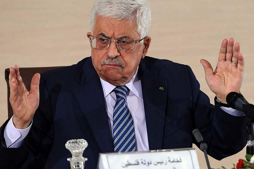 Palestinian President Mahmud Abbas speaks during a press conference held at the Ministry of Foreign Affairs on Tuesday in Algiers. Abbas is on a three-day official visit and met the day before Algerian President Abdelaziz Bouteflika. -- PHOTO: AFP