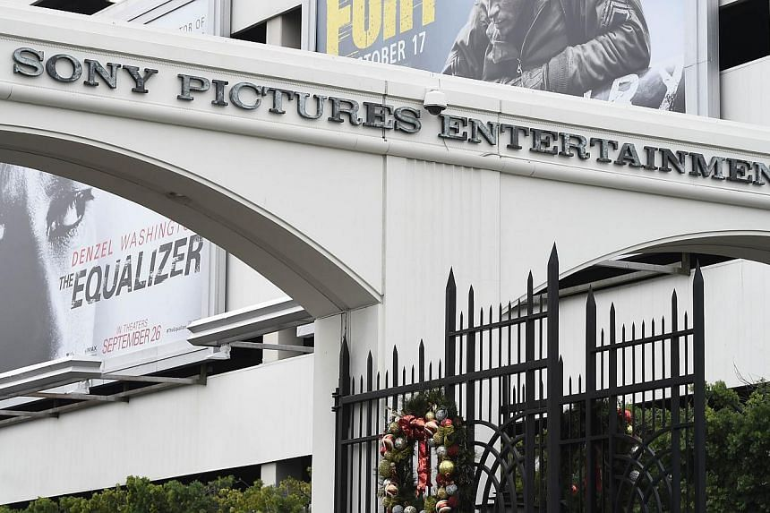 Sony Pictures has threatened Twitter with legal action unless it removes confidential material stolen from the movie company's computers that someone has posted on the social networking site. -- PHOTO: AFP