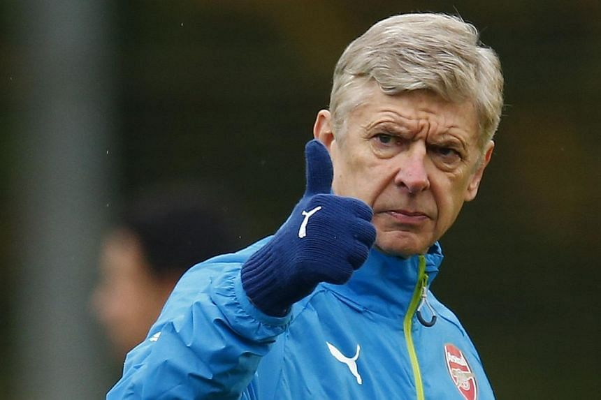 Arsenal must use the busy Christmas and New Year fixture schedule to show their English Premier League rivals that they mean business after a sluggish start to the season, manager Arsene Wenger said on Tuesday. -- PHOTO: REUTERS