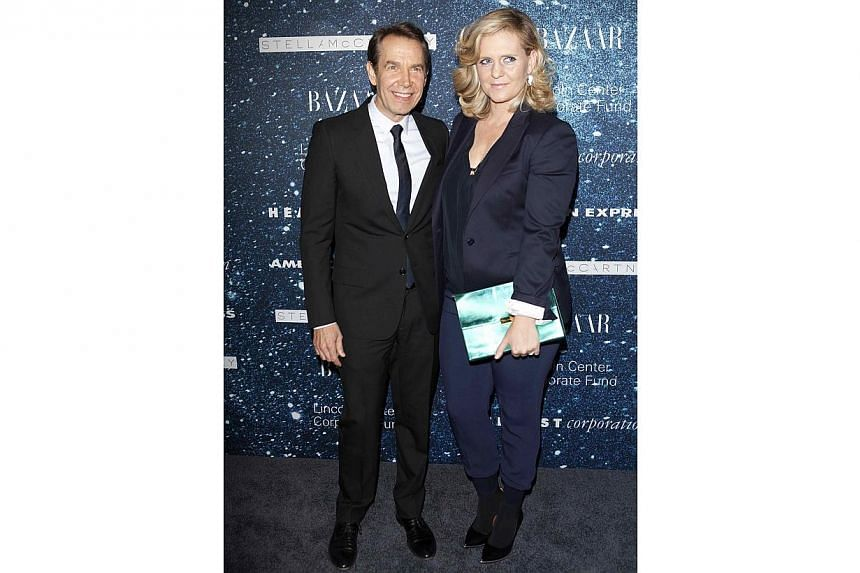 Artist Jeff Koons and wife Justine Wheeler Koons at the 2014 Women's Leadership Award honouring Stella McCartney at Alice Tully Hall in New York on Nov 13, 2014. A sculpture by US pop artist Jeff Koons has been pulled from a retrospective of his work