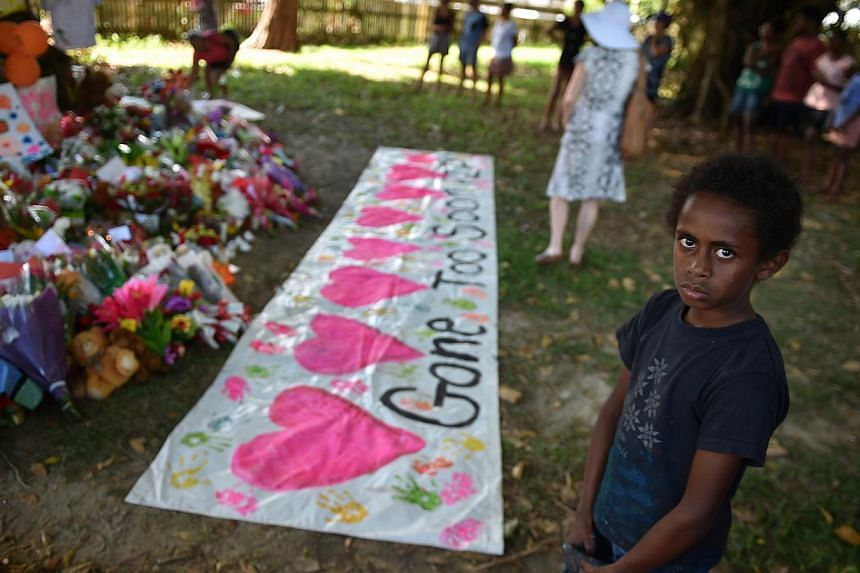 Local children at a makeshift memorial at the scene where eight children ranging from babies to teenagers were found dead in a house in the northern Australian city of Cairns. The grandfather of seven of the children made an impassioned plea on Wedne