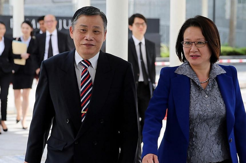 Workers' Party Chairman Sylvia Lim and her Lawyer Peter Low arriving at court on Dec 24, 2014. -- ST PHOTO: WONG KWAI CHOW