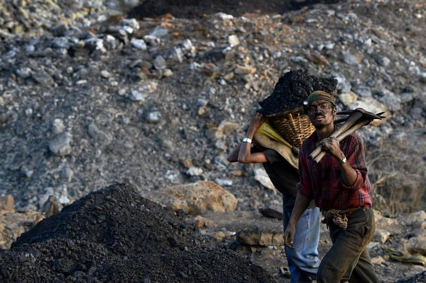In this file photograph taken on Jan 31, 2013, miners exit the shaft of a coal mine near Mulang village in the Indian northeastern state of Meghalaya.Indian Prime Minister Narendra Modi resorted to a rarely-used executive decree on Wednesday to