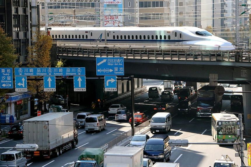 A Shinkansen bullet train passes over a road in Tokyo on Dec 8, 2014.Japan, fearing it could be a soft target for possible North Korean cyberattacks in the escalating row over the Sony Pictures hack, has begun working to ensure basic infrastruc