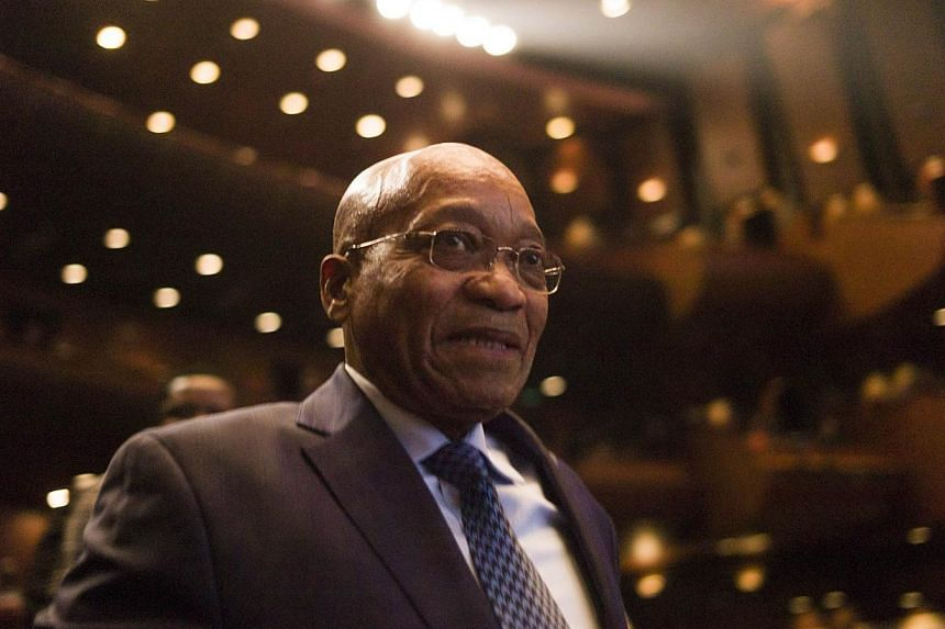 South African President Jacob Zuma prepares to deliver a speech during the closing ceremony of the 2014 Year of South Africa in China cultural exchange programme at the Tianqiao Theater in Beijing on Dec 5, 2014.South Africa's President Jacob Z