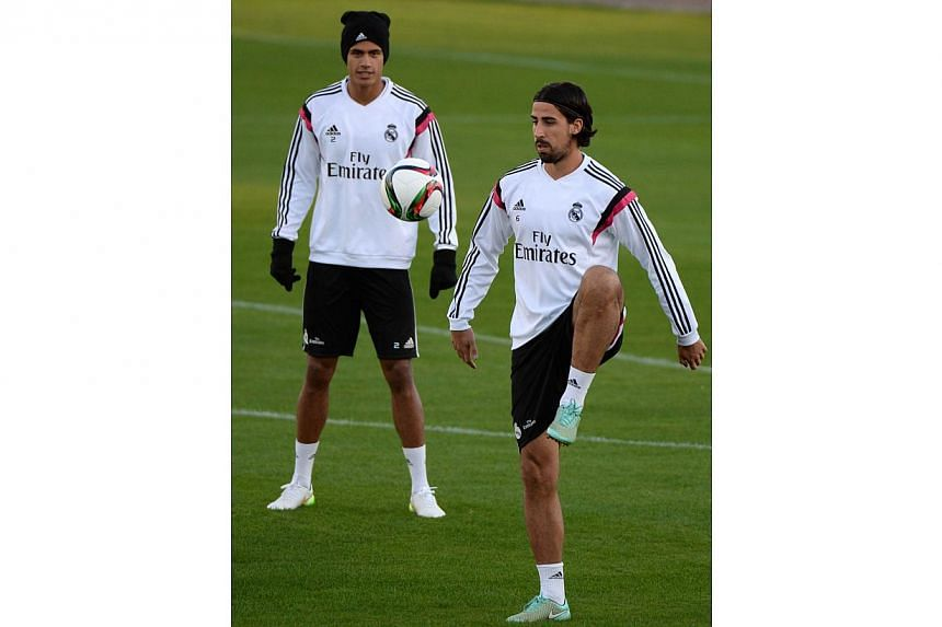 Real Madrid's German midfielder Sami Khedira (right) takes part in a training session at Crown Prince Moulay el-Hassan Stadium in Rabat on Dec 15, 2014, on the eve of his Club World Cup semi final football match against Mexico's Cruz Azul FC. --PHOTO