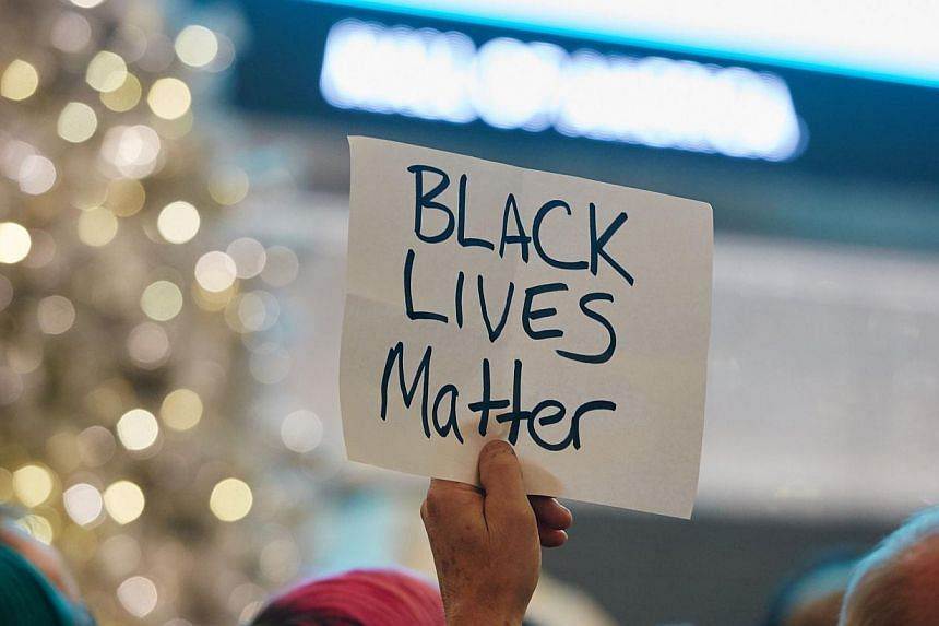 """Thousands of protesters from the group """"Black Lives Matter"""" disrupt holiday shoppers on Dec 20, 2014 at Mall of America in Bloomington, Minnesota. The phrase has become a rallying cry for demonstrators across the United States protesting grand jury d"""