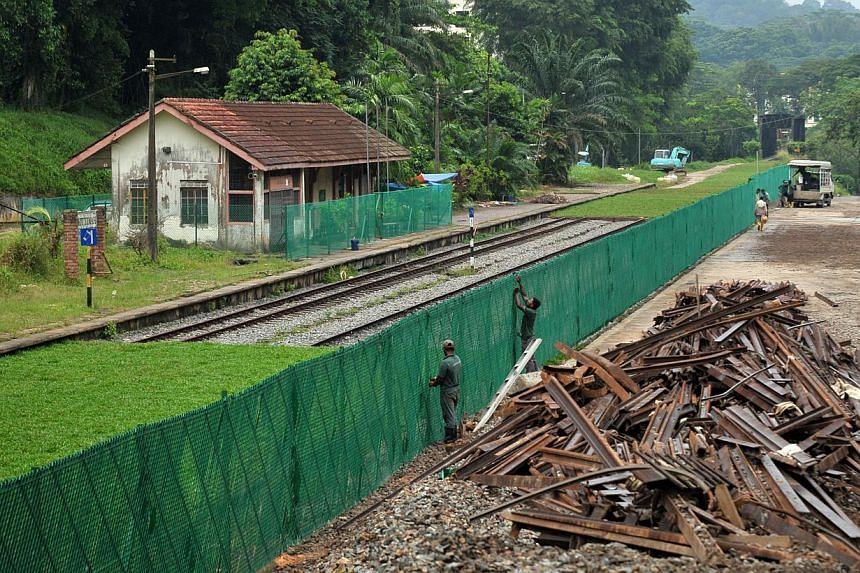 Track removal work progresss at the KTM Bukit Timah railway station. Experts believe that the distance between Singapore and Kuala Lumpur is ideal for a high-speed rail. --STPHOTO: ALPHONSUS CHERN