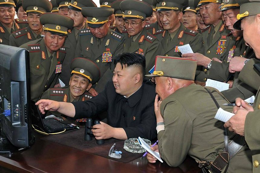North Korean leader Kim Jong-Un (centre) looking at a computer in April as he inspects a shelling drill of a long-range artillery sub-unit. North Korea's Internet went dark again Tuesday amid rumors of US retaliation over its alleged hacking of a Hol