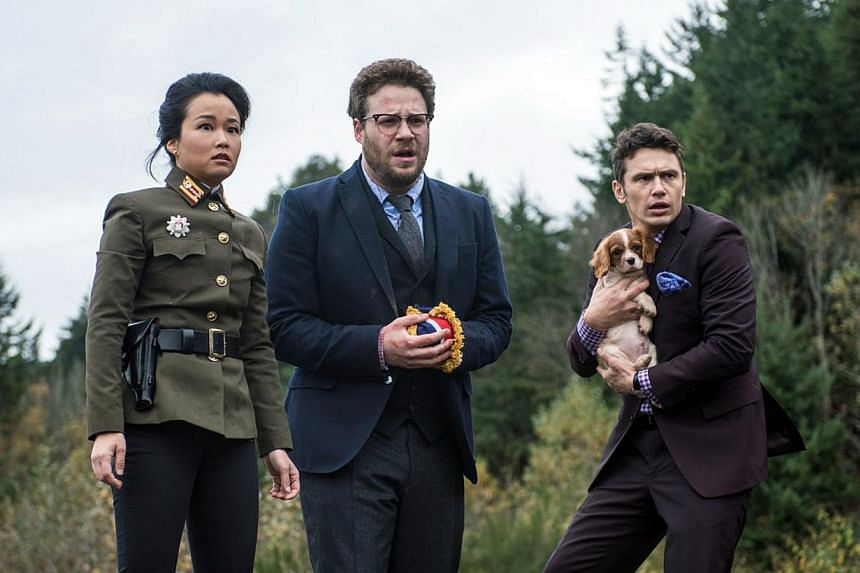 The Interview stars Seth Rogen (centre) and James Franco (right), shown here in a cinema still from The Interview with Diana Bang, hailed Sony's reversal of its original decision to cancel the film's showing and to allow its limited release on Thursd