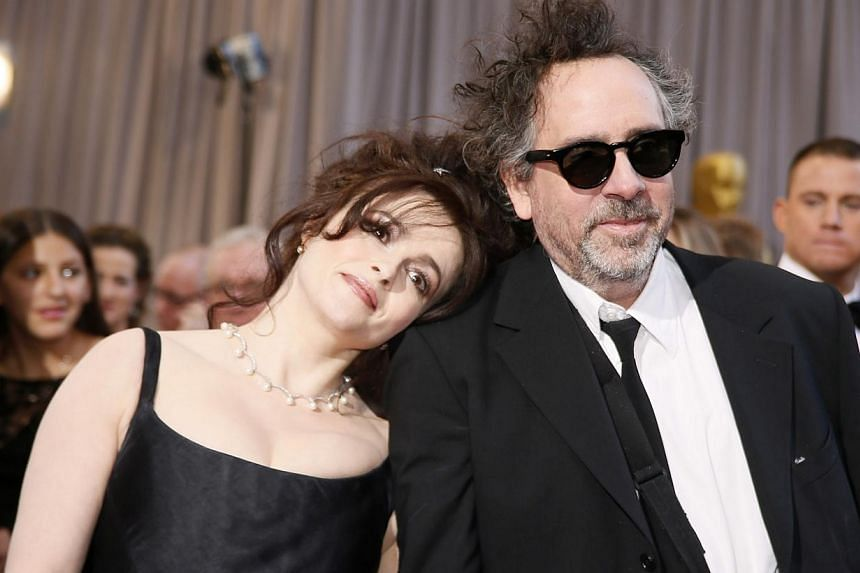 British actress Helena Bonham Carter (left) rests her head on the shoulder of her partner, director Tim Burton, nominee for Director of Best Animated Feature film Frankenweenie, at the 85th Academy Awards in Hollywood, California in this file photo t
