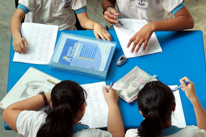 Students in Singapore are among the world's most hard-working at home, clocking the third-longest time spent on homework. -- PHOTO: ST FILE