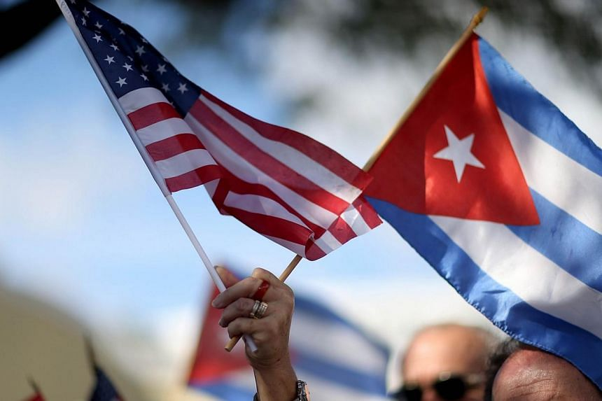 Cuban expatriates in America, including many who risked their lives to escape the communist island, are torn about whether to return after Havana and Washington formally reestablish ties next year. -- PHOTO: AFP