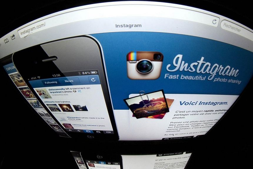 "Iran has started censoring images posted on photo sharing app Instagram, removing content deemed ""offensive"" as part of a government project to screen social networking accounts, local media reported on Thursday. -- PHOTO: AFP"
