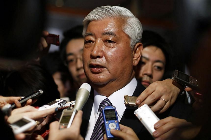 Japan's new Defence Minister Gen Nakatani (pictured) surrounded by reporters at Prime Minister Shinzo Abe's official residence in Tokyo on Dec 24, 2014. -- PHOTO: REUTERS
