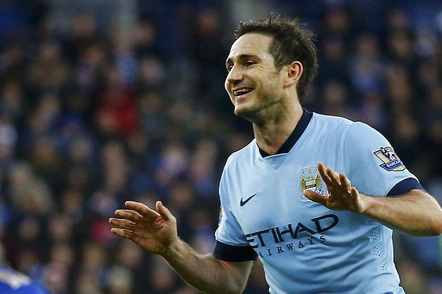 Manchester City's Frank Lampard celebrates his goal during their English Premier League soccer match against Leicester City at the King Power Stadium in Leicester, central England on Dec 13, 2014. -- PHOTO: REUTERS
