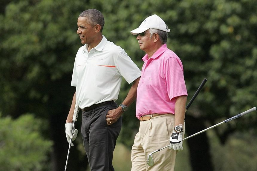 US President Barack Obama and Malaysia's Prime Minister Najib Razak walk off 18th hole while playing a round of golf at the Clipper Golf course on Marine Corps Base Hawaii during Mr Obama's Christmas holiday vacation in Kaneohe, Hawaii, on Dec 24, 20