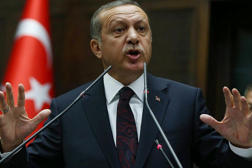 Turkey's Prime Minister Recep Tayyip Erdogan speaking to members of Parliament from his ruling Justice and Development (AKP) Party during a meeting at the Turkish parliament in Ankara on Apr 8, 2014. A high school student has been arrested in central