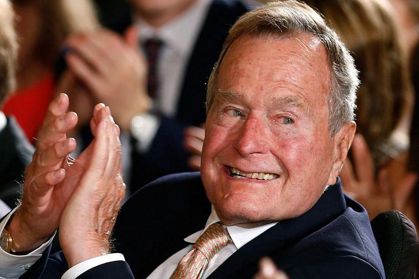 Former US president George H.W. Bush, 90 (above, in a 2013 file photo), remained in a Houston hospital on Wednesday as a precaution after experiencing a shortness of breath, a spokesman for the 41st president said. -- PHOTO: REUTERS