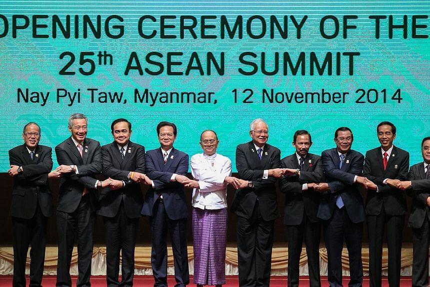 (From left) Philippine President Benigno Aquino, PM Lee Hsien Loong, Thai Prime Minister Prayuth Chan-ocha, Vietnamese Prime Minister Nguyen Tan Dung, Myanmar President Thein Sein, Malaysian Prime Minister Najib Razak, Brunei's Sultan Haji Hassanal