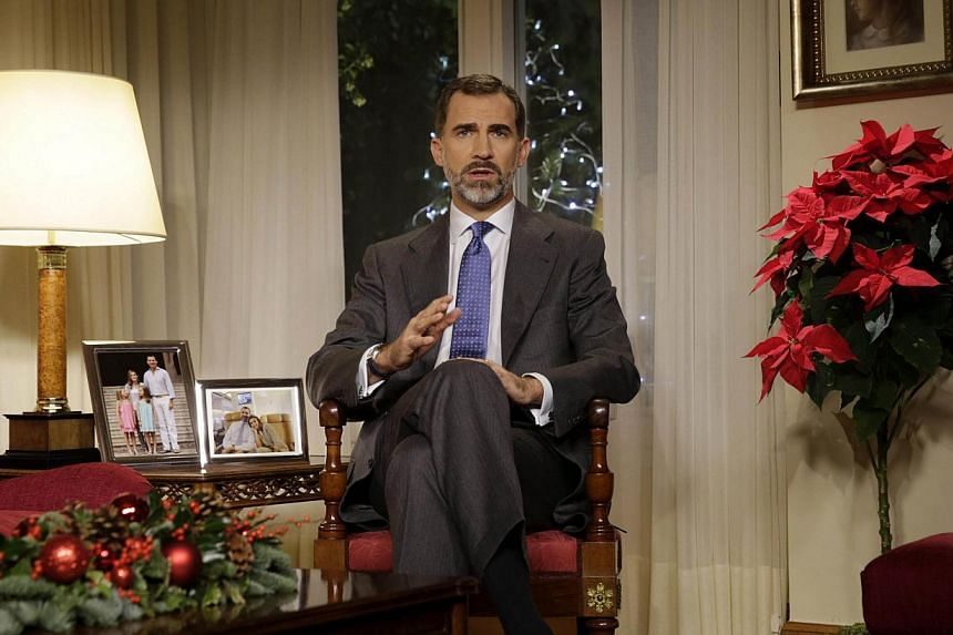 Felipe VI of Spain delivers his first Christmas Eve message as King at the Zarzuela Palace in Madrid on Dec 24, 2014, lashing outagainst corruption but making no direct reference to his sister, Cristina de Borbon, who was ordered on Monday to s