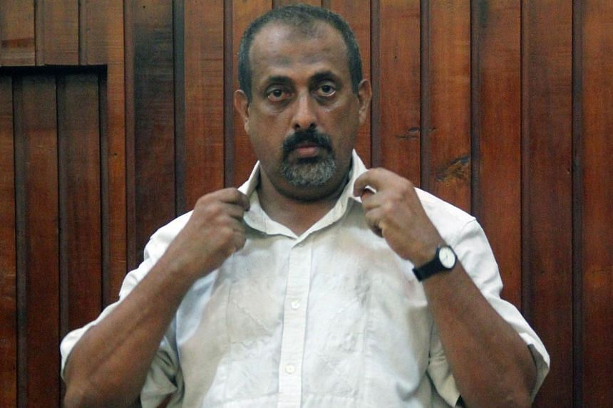 Kenyan national Feisal Mohammed Ali stands in the dock at a Mombasa court on Dec 24, 2014, after being handed over by Tanzanian authorities. -- PHOTO: AFP