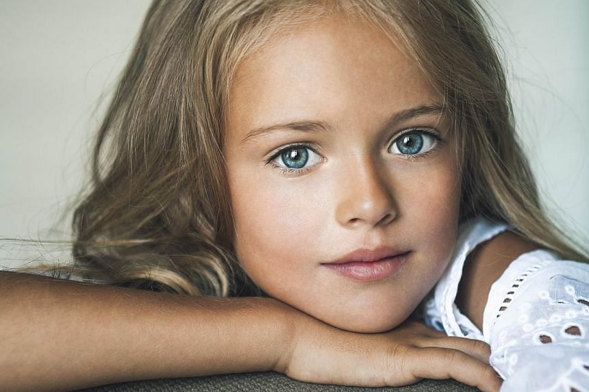 Russia mother insists worlds most beautiful girl is sheltered this handout photo released on dec 11 2014 by the pimenova family shows russian child thecheapjerseys Gallery