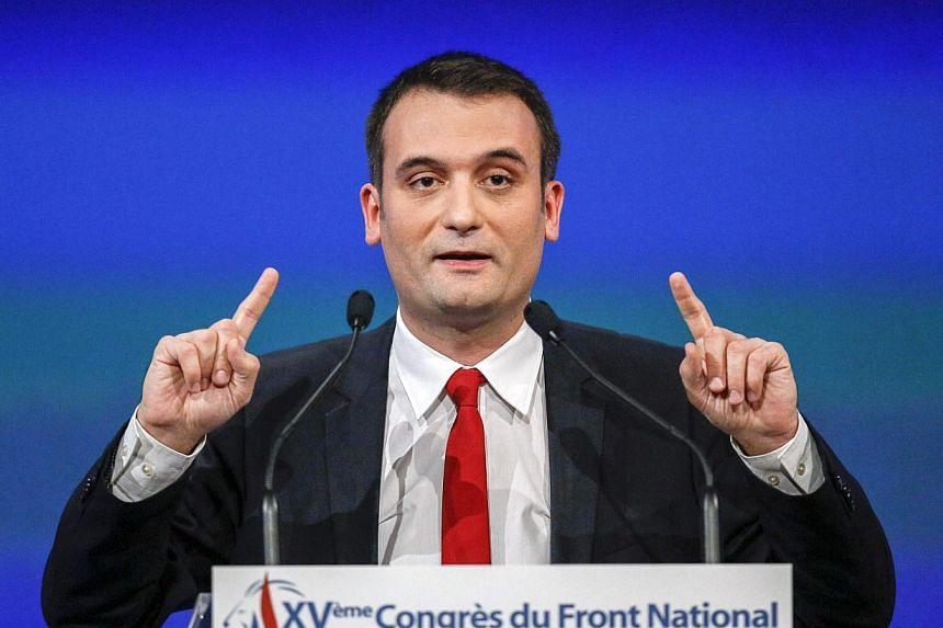 """Florian Philippot, France's far-right National Front political party vice-president, delivers a speech during the party's congress in Lyon Nov 29, 2014. Gossip magazine Closer has been ordered by a court to pay €20,000 (S$32,000) in damages for """"in"""