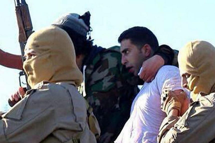 A still image released by the Islamic State group's branch in Raqa on extremist websites on Dec 24, 2014 purportedly shows a Jordanian pilot captured by Islamic State in Iraq and Syria group fighters after they shot down a warplane from the US-led co