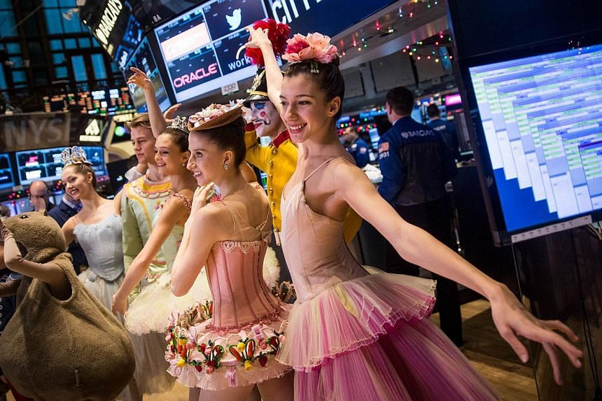 New York City Ballet dancers from this year's production of The Nutcracker visit the floor of the New York Stock Exchange on the morning of Dec 24, 2014 in New York City.The Dow on Wednesday edged to a fresh record in a holiday-shortened sessio