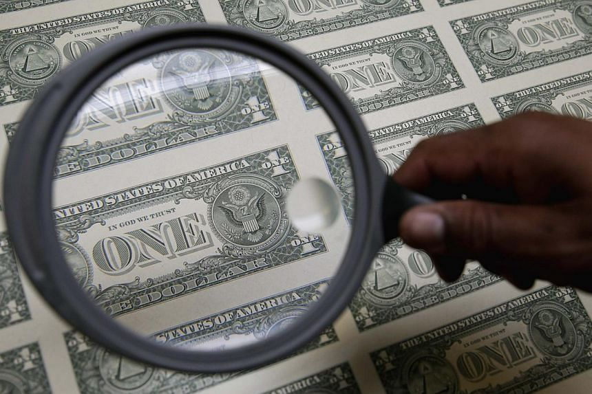 The US dollar has strengthened against the currencies of every Asian economy as well as those of the major economies elsewhere in the world. -- PHOTO: REUTERS